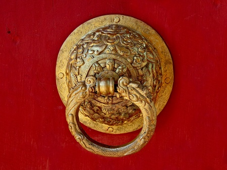 The Vintage knocker of golden dragon isolated on white background photo