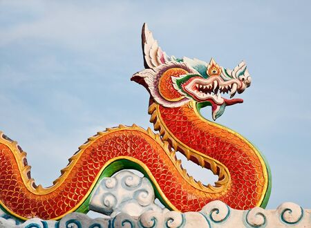 The Red dragon status on sky background Stock Photo - 12624316