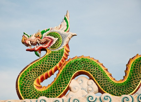 The Green dragon status on sky background photo