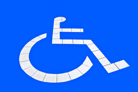 The Reserved car park for handicapped isolated on blue background photo