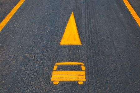 The Sign yellow arrow of oneway car on asphalt floor ground photo