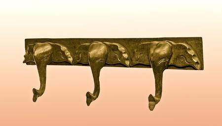 The Hanging wooden of elephant isolated on white background photo