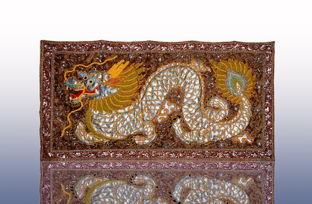 The Handmade woven fabrics of dragon in thai photo