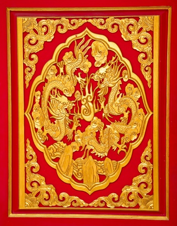 The Golden dragon on red wall Stock Photo - 12891561