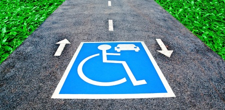The Reserved car park for handicapped on road photo