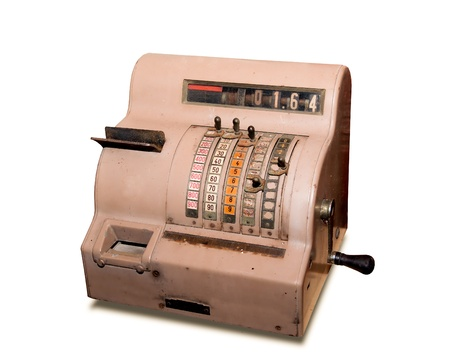 The old cash register isolated on a white background photo