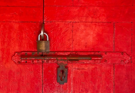 The Old master key and old bolt on red wooden door Stock Photo - 13148586