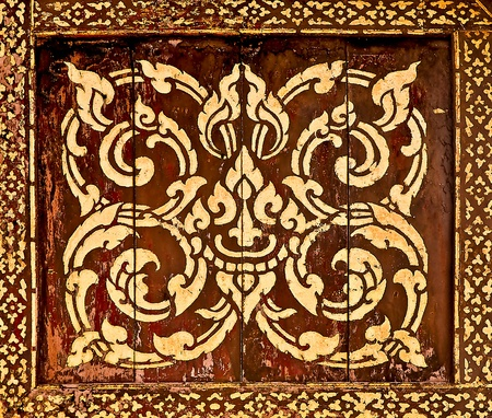 thai painting: The Traditional Thai style art golden painting pattern on wood in temple. This is traditional and generic style in Thailand. No any trademark or restrict matter in this photo. Stock Photo