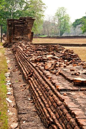 The Old ruin brick wall of Si Satchanalai historical park at sukhothai province,Thailand photo