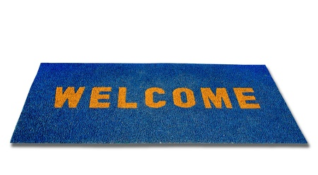 The Doormat of welcome text on wood background photo