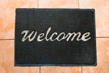 The Doormat of welcome text on wood background Stock Photo - 13228725