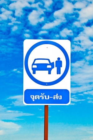 The Sign of shuttle bus or taxi isolated on blue sky background photo