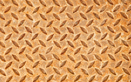 The Grunge rusted steel floor plate background texture photo