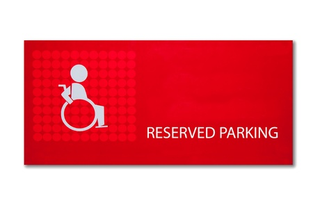 The Sign of reserved parking for handicap isolated on white background photo