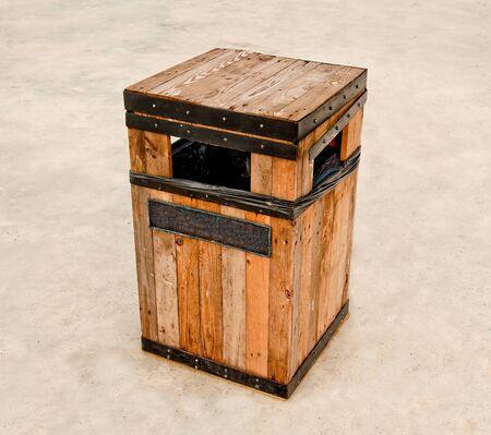 The Wooden litter bin on cement floor