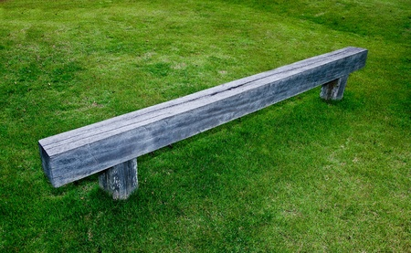 The Wooden bench on green grass floor photo