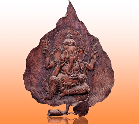 painted wood: The Carving wood of ganesha on reflect background
