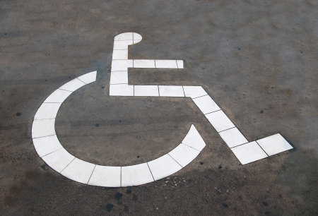 The Reserved car park for handicapped isolated on cement floor background photo