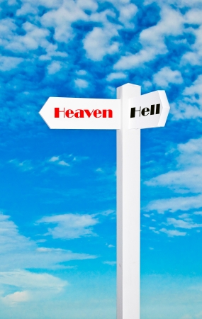 The Sign of direction to heaven or hell isolated on blue sky background Stock Photo - 14085196