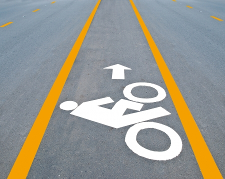 road bike: The Bicycle road sign painted on the pavement