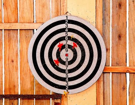 The Dartboard on wood background photo