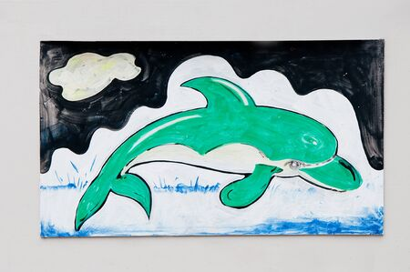 The Painting of dolphin on wall photo