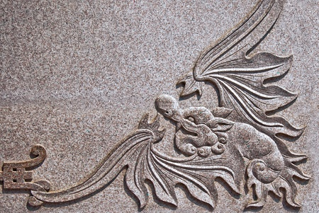 The Carving dragon on rock photo