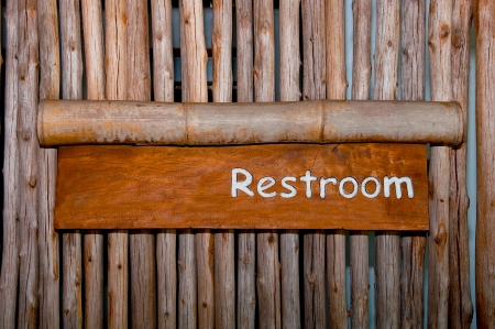 The Sign of restroom on wood background photo