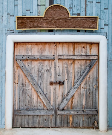The Old wooden door in farm photo