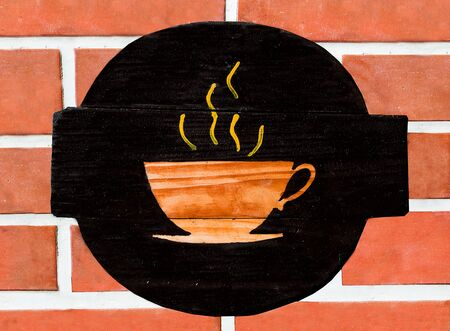 The Sign a cup of coffee on wall background photo