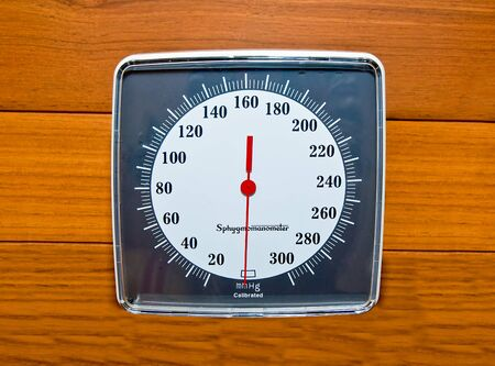 The Sphygmomanometer on wood wall Stock Photo - 14346967