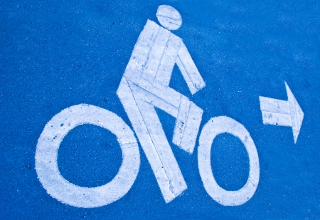 The Bicycle road sign painted on the pavement photo
