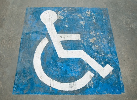 The Sign of public restroom for handicapped photo