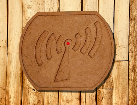 The Sign of wi-fi zone on wood background photo