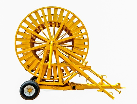 Old Spinning straw machine isolated on white background photo