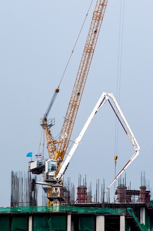 Tower crane and reinforced building under construction photo