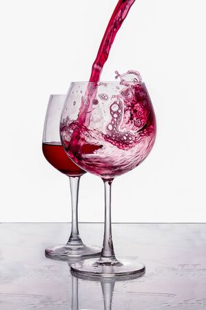 pouring red wine isolated on white background photo