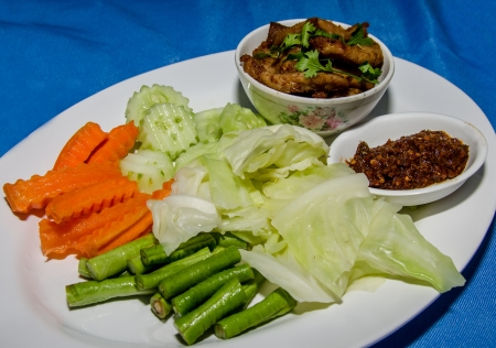 Thai Cuisine call 'nam prik' and fried pork with vegetables photo