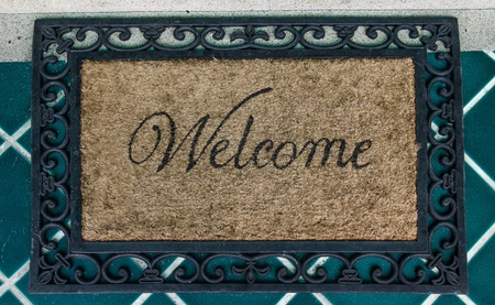 The Doormat of welcome text on floor background Stock Photo - 17678346