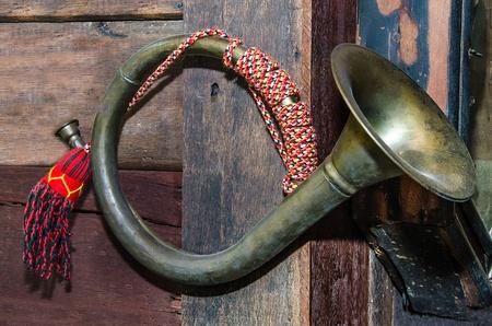 bugle: Old Bugle on wood wall