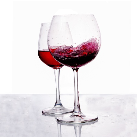 A glass of red wine isolated on white background photo