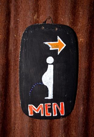 Sign of public restroom for men photo