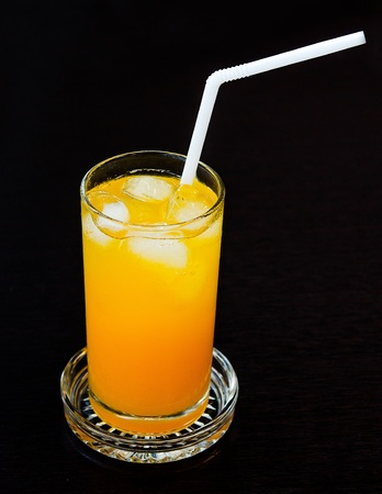 A glass of orange juice photo