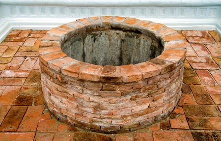 Ancient brick well photo