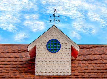 weathercock: Old weather vane on roof top Stock Photo