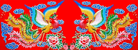 Colorful of twin phoenix on wall of  joss house photo