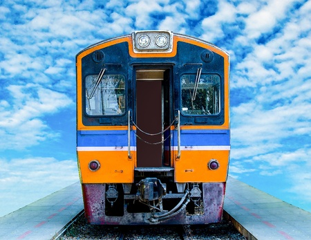 Diesel locomotive train isolated on blue sky background photo