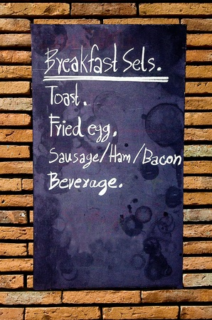 Menu breakfast blackboard on wall photo