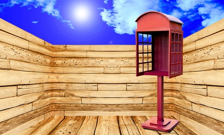 Red telephone box with perspective view on blue sky background photo