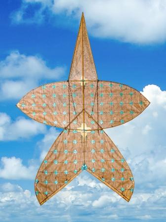 Old kite thai style on blue sky background